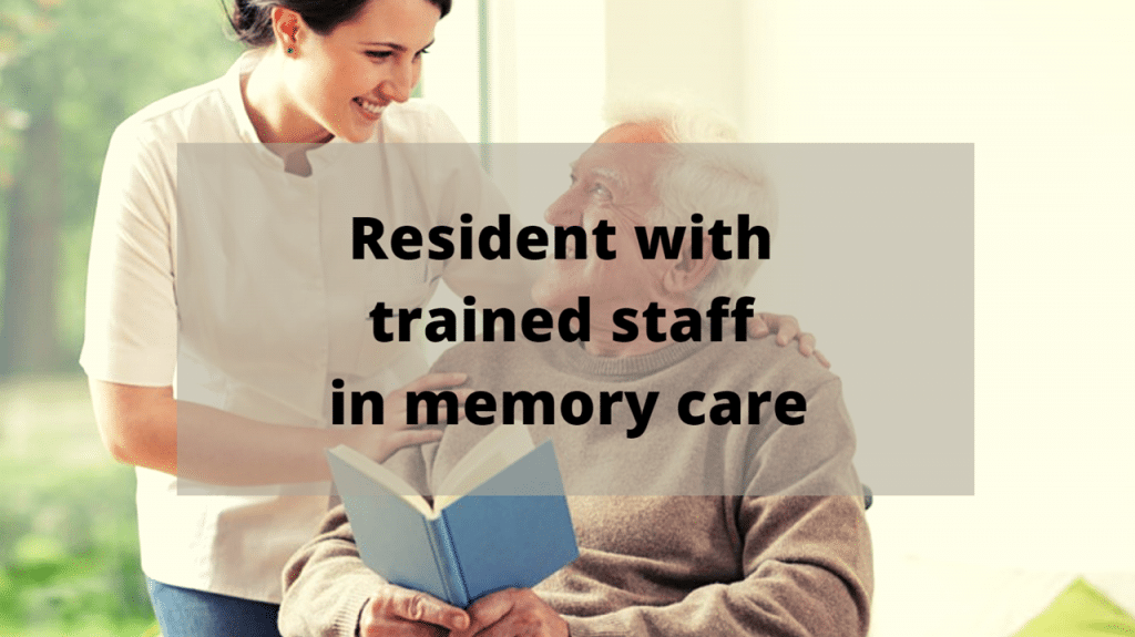 Resident with trained staff in memory care